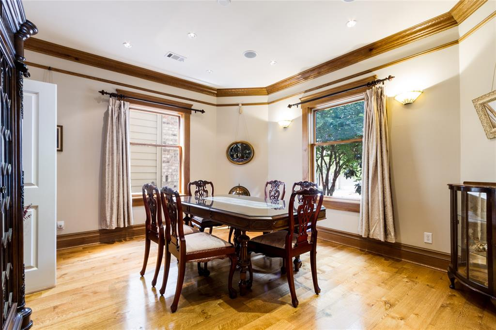 Formal dining room adjacent to the kitchen and butler's pantry features beautiful wood floors, crown molding and picture rail.