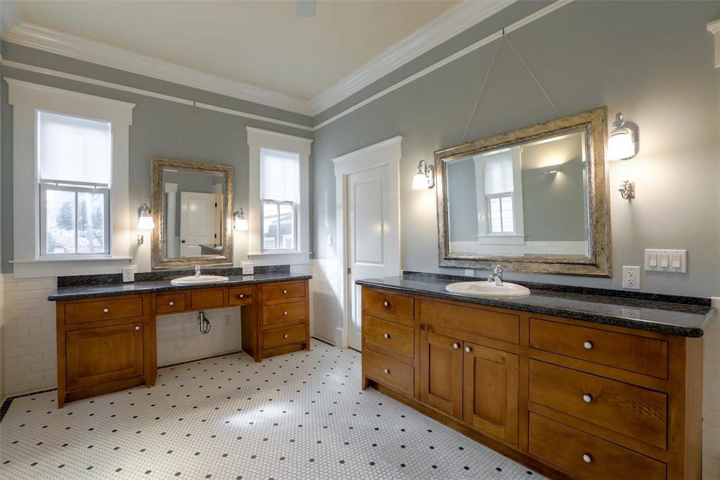 Luxurious master bath with custom dual vanities and heated floors.