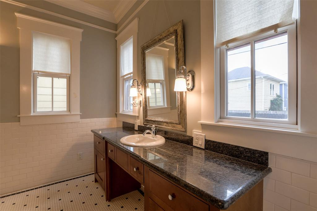You'll love starting your day in this luxurious space.  No detail was sparred with the beautiful trim and crown molding.