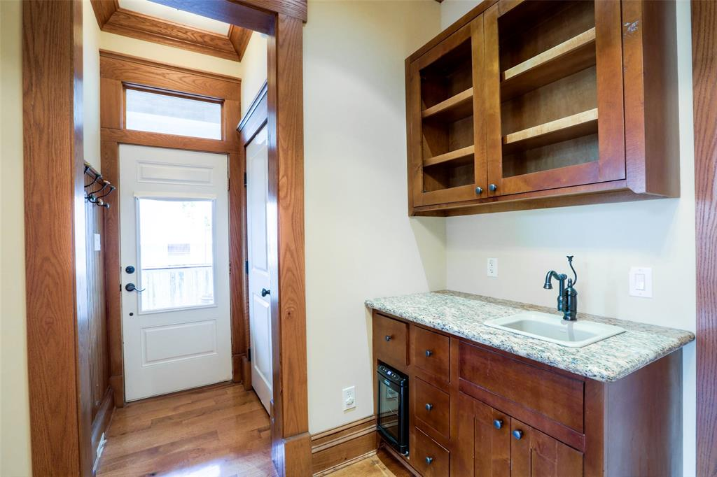 Wet bar on the first floor with easy access to the covered porches.