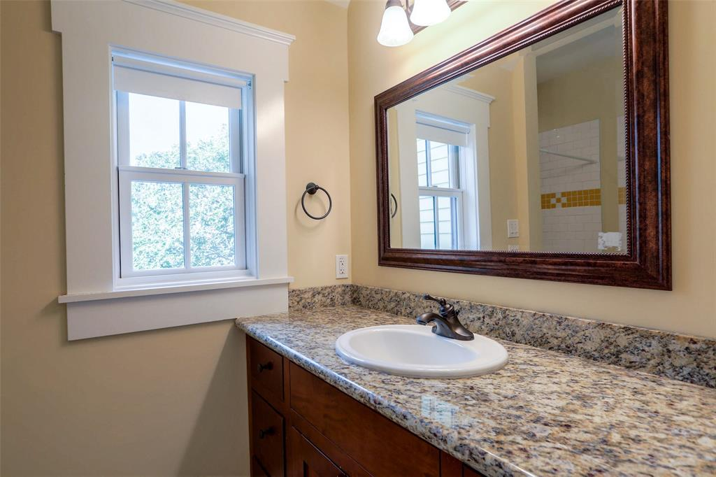 Full bath # 2 with custom vanity and granite counter top.