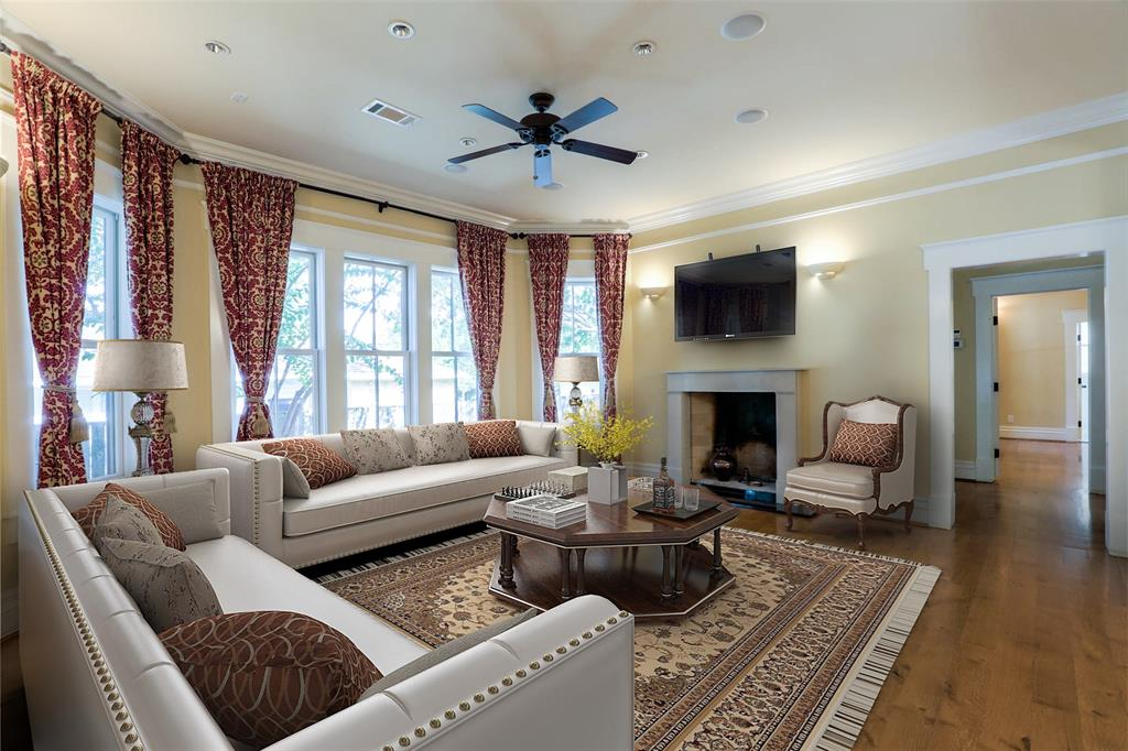 The study on the first floor features wide plank white oak floors and custom crown molding, base and trim.