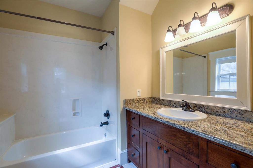 Full bath # 3 with custom vanity and granite counter top.