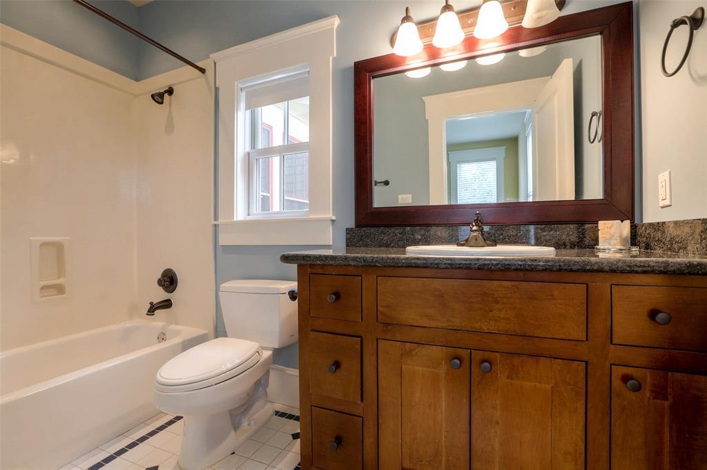 Full bath # 4 with custom vanity and granite counter top.