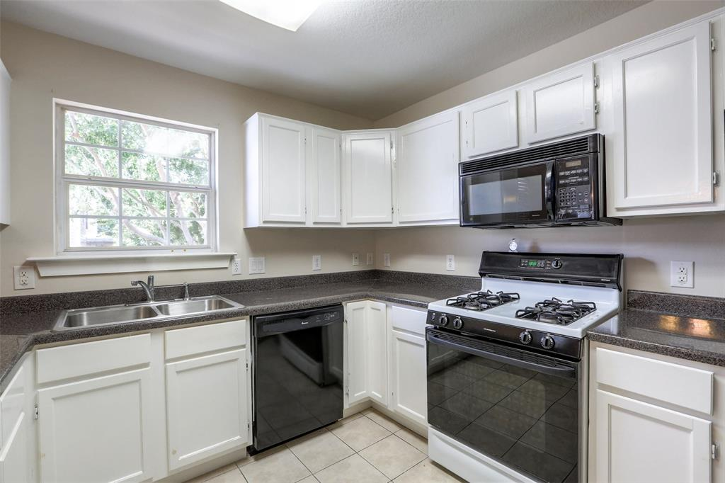 Guest quarters kitchen with lots of storage.