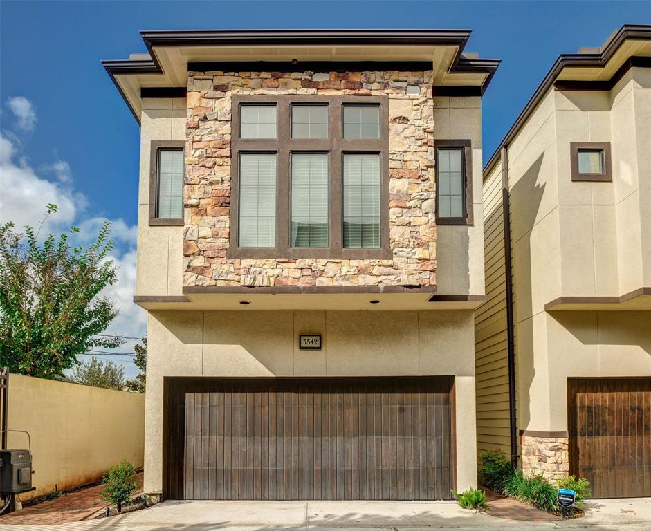Located in an exclusive gated community within the Washington Street Corridor. The first floor living, dining and kitchen has real hand scraped hard wood floors, surround sound speakers, raised ceilings and crown moldings. The gourmet kitchen is complete with custom cabinetry, Bosch appliances, large island, granite counter tops, and mosaic glass backsplash. A well designed second floor with 3 spacious bedrooms touting large closets. Waking up in this private master suite will brighten every day. Abundant natural light is provided by a wall of windows. The luxurious master bath has a separate shower, tub, travertine floor, and a double vanity with granite counter tops. The full two-car garage also has overhead storage. Fresh paint with modern color scheme throughout makes this home ready for you to move in immediately. This comfortable home is very clean and is great for hosting! HOA takes care of outdoor landscaping. Additional reserved gated parking in front of garage. Come see it!