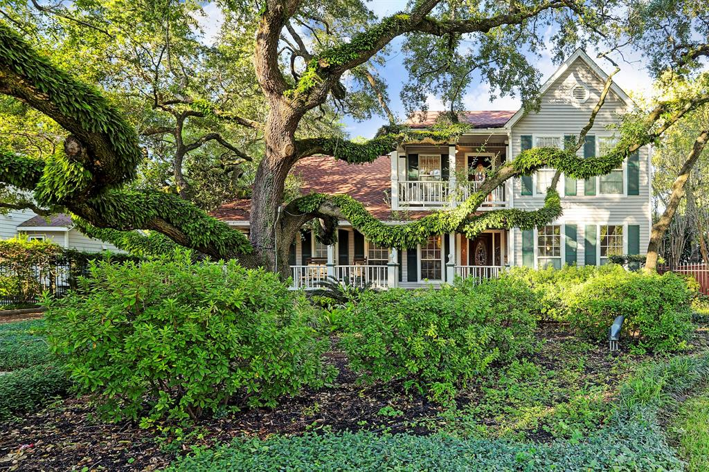 "This is the house with ""the tree"" – one of the stateliest oaks in Garden Oaks that graces the entire front of this property. Custom built in 1987, this unique two story residence was one of the first new builds in Garden Oaks. Classic, sizeable Southern front porch with ceiling fans and rockers, leaded front door, formals with custom antique mantles on double sided fireplace. Hardwood floors, granite counters in kitchen. Angled walls, tremendous use of space. Large office/studio approximately 29x19 is on the first level and offers numerous possibilities. Master and its sitting room (xr) are upstairs along with 2 secondary bedrooms. The lush back yard offers an in ground vinyl lined pool, covered deck with numerous seating areas, and a ground level one bedroom guest house (appx 600 sq.ft. per hcad) with full kitchen & w/d. Roof replaced 2016."
