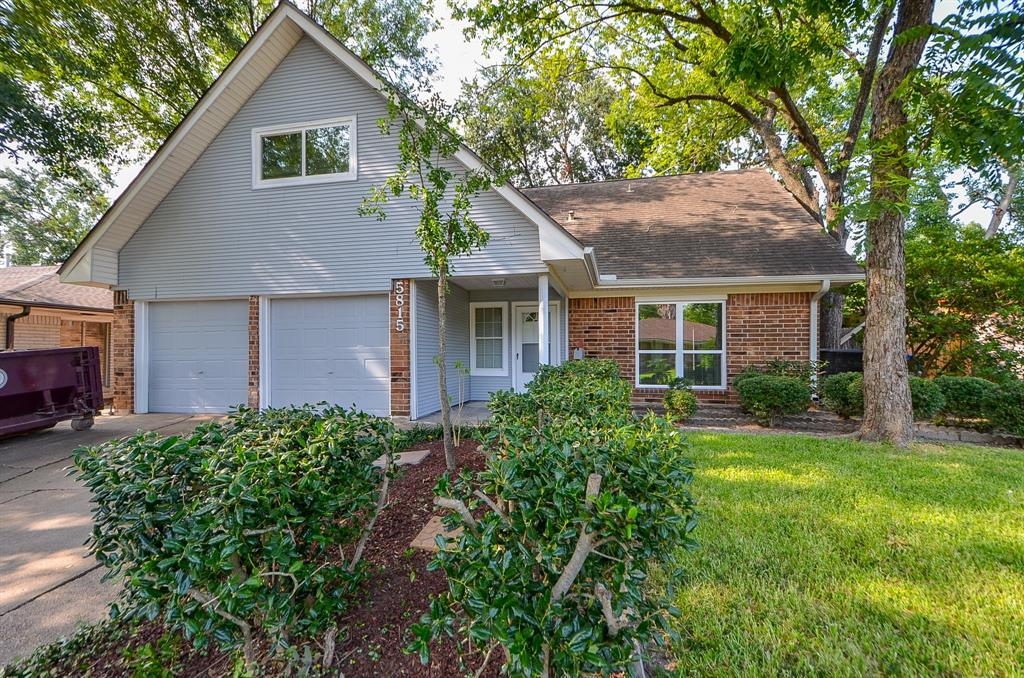 "DID NOT FLOOD DURING HARVEY! WELCOME HOME! Come visit this stunning UPDATED/FRESHLY PAINTED home in an established and peaceful neighborhood. This home features 5 bedrooms, with the master down and 4 upstairs! The first floor features a large living area open to the kitchen/breakfast area for entertaining and a Formal Dining room for Family Dinners. NEW 18"" tile in the common areas and NEW carpet in the bedrooms! Stainless steel appliances, beautiful granite countertops and stunning backsplash make this kitchen stand above the rest! Spacious Master bedroom with great closet space. The upstairs features 4 bedrooms, Or a Flex room, that would be a perfect game room or anything you can think up! There is a 2 car attached garage AND a 2 car detached garage behind the home! NEW WINDOWS THROUGH OUT THE HOME!!! DID NOT FLOOD DURING HARVEY!!"