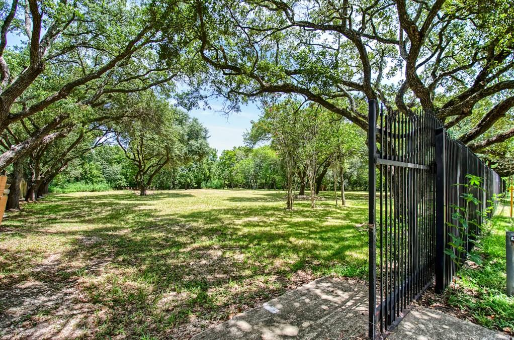 Beautiful 1.37 Acres surrounded by mature Oak Trees. Clear land ready to build! No Restrictions/No HOA. Land can be used as Residential or Commercial. Already set up with Electric Well, Septic System, and Commercial-Grade Lighting surrounding entire property! The Wrought Iron fence also has 2 sliding gates for easy access in and out of the property. This land can be perfect for a custom home or Commercial Building with close access to I-10. A hidden gem that must seen to appreciate. The possibilities are endless!