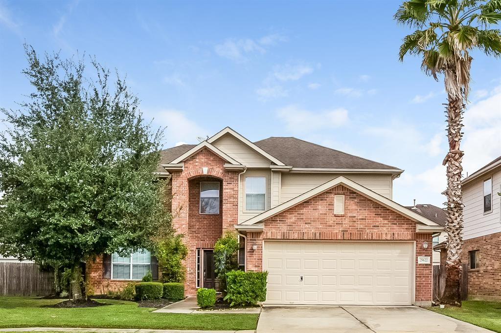 Beautiful brick front home offering an open floor plan, hardwood flooring, granite countertops in the kitchen, spacious bedrooms, and natural light throughout.
