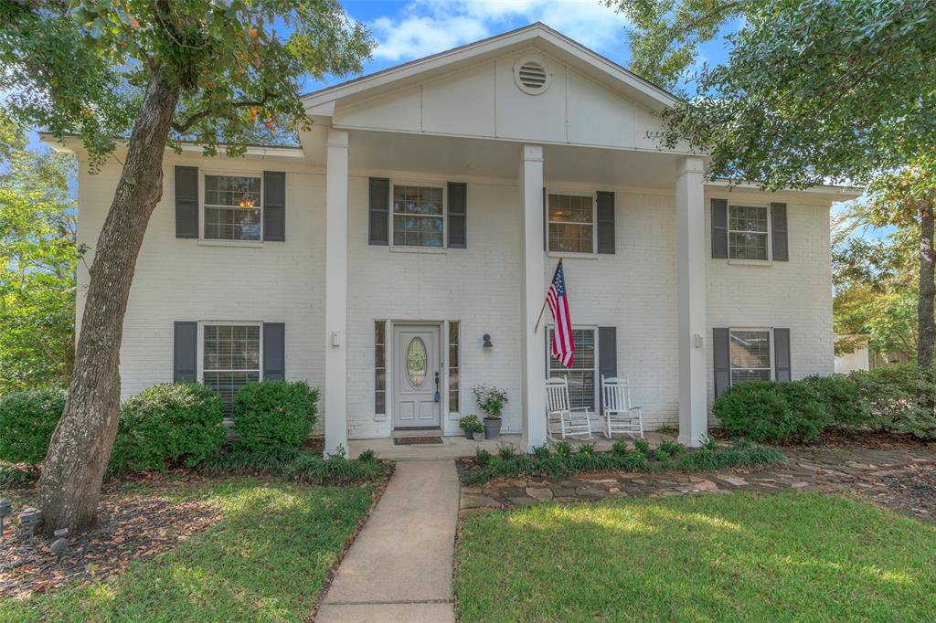 Only 3 minutes from the Woodlands Waterway, Market Street and Pavilion, 12 minutes from the Exxon campus and 30  minutes to downtown - the location of this classic Oak Ridge North gem cannot be beat! From its stately colonial columns to its huge fruit tree filled back yard, this home is welcoming and charming!  It has four bedrooms upstairs with hardwoods throughout and custom trim work & designer paint, 2 full baths up and a powder down.  An expansive front room can serve so many purposes and is fantastic for entertaining and hosting groups.  Built ins with lighting and marble counters accent the dining and living areas.  The kitchen and breakfast nook offer bright areas to gather and relax. Laundry room is spacious, with plenty of counter space and a beverage refrigerator. You will not believe the size of this yard! Fridge, TV in living stay.   Hurry - this one will be gone in a flash! HIGH AND DRY IN HARVEY!