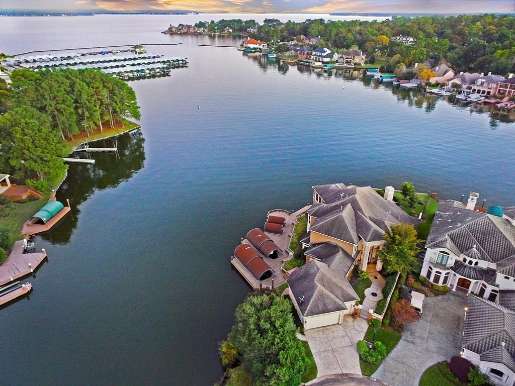 Custom waterfront home on cul-de-sac in gated Bentwater. Panoramic 180 degree views of Lake Conroe. Covered patio, summer kitchen, hot tub and 2 covered boat slips; Master bedroom and second bedroom downstairs; Gourmet, granite Chef's island kitchen with breakfast bar; Thermador double ovens and Sub-Zero refrigerator; Formal dining; Game room with wet bar, media room and 2 bedrooms upstairs.