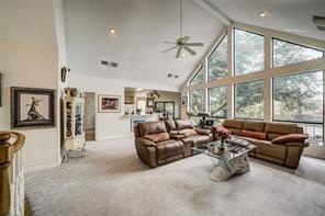 Main living area of the home with plenty of picture windows to let in natural light and view Lake Conroe from.