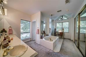 Master bath has a jetted tub, walk in shower, dual vanity area, and double closets.