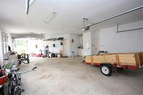 Over-sized two car garage has room for two cars plus a golf cart, or workshop area.