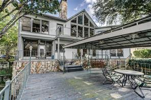 View of the covered canopy over the boat slip, this is a great outdoor space to enjoy the views of Lake Conroe from.