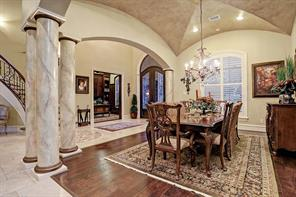 Impeccable detailing accompanies the dining room where faux marbleized columns and groin vaulted ceiling heighten the appeal of the quality-laden room.