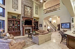 Architecture articulates the image of quality in the family room where the giant rock surround fireplace serves as the focal point of the spectacular room.