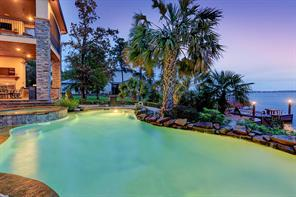Huge sparkling heated pool adds a dimension of enjoyment to the resort style living this home affords.
