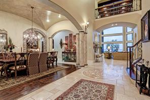 A travertine anchored gallery provides flexibility across the main floor, with the spacious living room, dining room and cooks kitchen all united by an open concept.