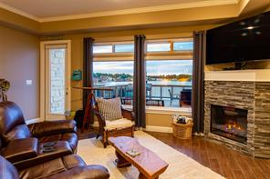 Living room with views of Lake Conroe