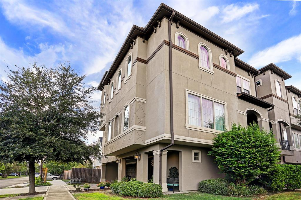 Beautiful ready to move in home with elegant custom fininshes large corner lot with driveway. Elegant entry with winding wrought iron staircase greets you as you enter along with adjacent bedroom with en-suite bath. Second floor features tons of natural light in the open family room, dining room and kitchen - perfect for large gatherings. Baker's kitchen offers tons of functional workspace, seated bar area and upgraded appliances and more. Nice relaxing balcony perfect for cooking or just enjoying a quiet evening. Third floor features stunning owners retreat and oversized bathroom with walk-in shower, garden tub, dual sinks, prep area and raised ceilings. Third floor also features a secondary bedroom with en- suite bath. Close access to I-10 and just blocks few blocks away from resturants and other area amenities.