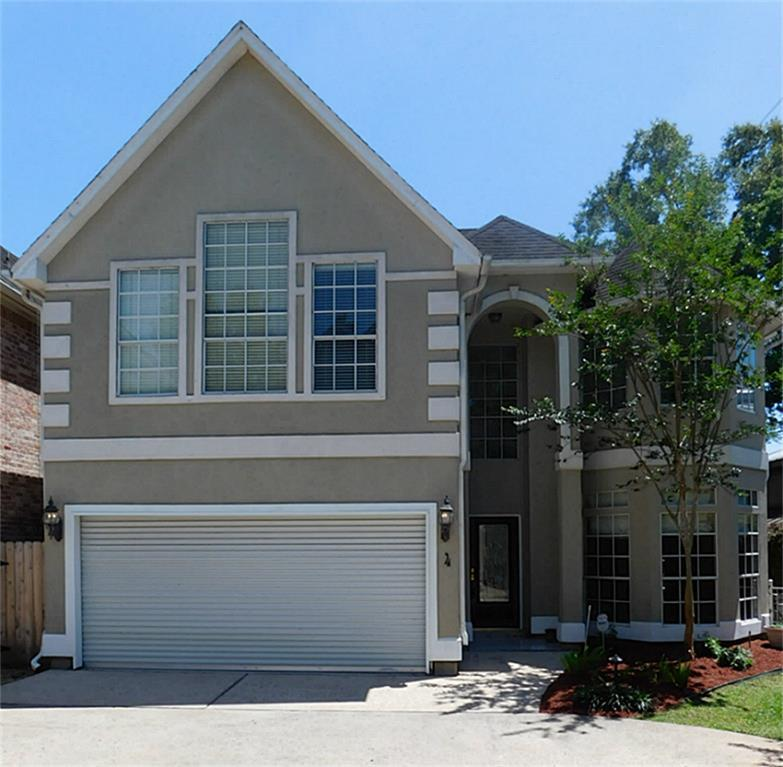 DID NOT FLOOD!  This home offers a beautiful floor plan with floor to ceiling windows in a bright living room that showcases a direct vent fireplace. Great kitchen with island and overlooks into family room. High ceilings downstairs, spacious master suite with Calif. closet system in master closet. Den and study up stairs with wall of built-ins. Beautiful Marble floor in dining room. Beautiful hardwood floors in entry, kitchen, living room. Garden and patio in back and maintenance free front yard.