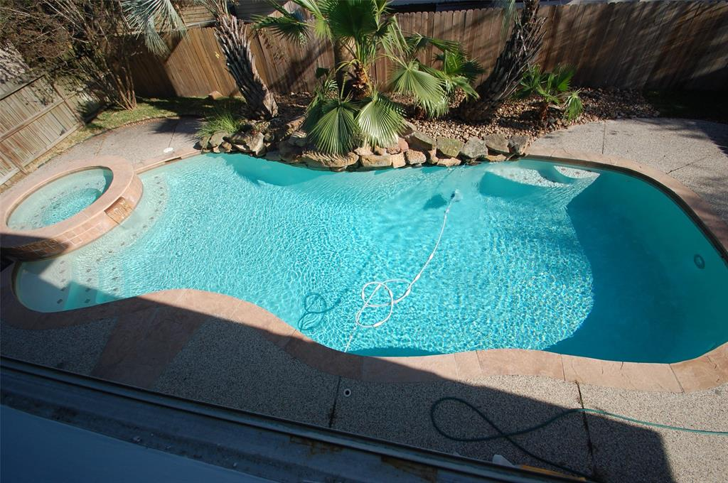 WOW !!!! Great rental with back yard oasis with a beautiful pool and spa.  Freshly painted and new carpet. Large living room with fireplace and wood laminated floors. Master suite on first floor with granite in master bath and separate tub and shower. Huge game room upstairs and two large bedrooms. Pool maintenance included plus yard maintenance.