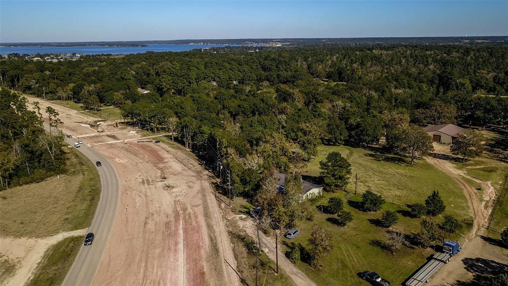 24+/- acres on sought after McCaleb Rd that joins the Lake Conroe Area and The Woodlands area.  This tract is within ONE mile of Hwy 105. Great topography with great views of the back pond. Over 1,000 ft of frontage on McCaleb Rd.