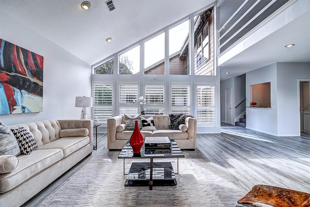 Beautiful modern & contemporary home in the Energy Corridor. This home sits on an elevation & because of that DID NOT FLOOD DURING HARVEY. Superb location! Only minutes walk or cycle to green-belt hike-and-bike trails. Wonderful connected living spaces & open-flow throughout the home. Gorgeous filtered morning & evening light throughout. Soaring ceilings, large chef's kitchen with an abundance of cabinet space, fresh paint, updated tile flooring throughout, & large utility room with washbasin & plenty of storage space. Downstairs wet bar & modern living room space are perfect for entertaining! Great sized, first floor, master bedroom with a private en-suite & large walk-in closet. Private view from the master of one of the outdoor areas with spa! The home boasts two fabulous separate outdoor spaces; one is inclusive of an in-ground spa area for entertainment! Beautiful & modern landscaping makes for easy yard maintenance. Come see this beautiful one-of-a-kind home today!