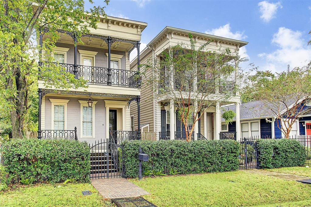 """French Quarter inspired home located in desirable Sunset Heights. Ornate iron double gallery porches done to accurate Creole design adds a nice touch of character. Home features refinished* hardwoods (2017), high ceilings, formal living and dining with two built-ins. Kitchen has stainless steel appliances, built-in microwave/wine chiller, tall upper cabinets to ceiling and New Orleans imported antique butcher block island top. Open family room with built-in entertainment center that will suit a 70"""" TV! The master suite has coffered ceiling and includes two closets and master bath with marble countertops, double sinks, separate shower and whirlpool tub. Two additional bedrooms with Jack & Jill bath – one bedroom offers access to balcony. Enjoy a nice evening in the back, bricked patio grilling or just relaxing to some good music. Alley access to two-car garage and double glass door from garage to patio. This charmer is full of character and one to see!  *Per Seller"""