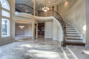 The formal dining room can be seen to the left, as well as the wet bar.