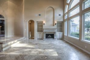 The fireplace has a large art niche and surrounding built-ins.  The master is beyond this area.