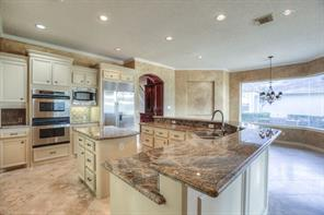 Double ovens, separate microwave, double islands, and built-in refrigerator!