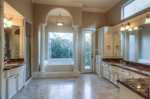 What a relaxing retreat! With double sinks, a separate shower, granite counter tops, and that soaking tub...what a wonderful space to start and end your day!