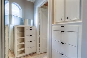 This is one of the two master closets. Plenty of built-ins for all your organizational needs!