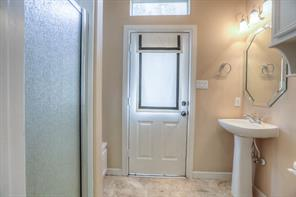 First floor powder room/mud room with separate shower and outside access.