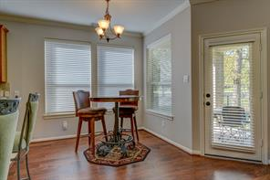 Breakfast room features new wood floors and paint. The door leads to the covered back patio.