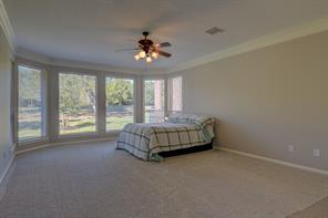 Plenty of room in the master bedroom to have a sitting area with a view of the golf course.