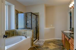 Large master bath with garden tub and separate shower.