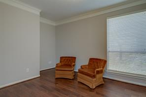 The office boasts new wood floors and paint. It is located just to the right of the front door.