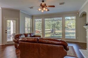 Living room has new wood floors and paint. A gas fireplace and large windows with a great view of the golf course.