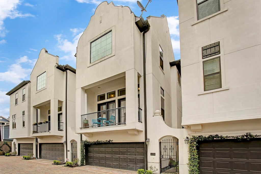 "Stunning contemporary 3/3.5/2 Stucco elevation in the heart The Heights.  Inner city vibes on Gated side yard + paved deck,  large Balcony & sitting areas overlooking quiet community. Custom stone-tile foyer, Rich Hardwood flooring throughout & Oak stairs. 12"" ceilings & Bright Suite with full bath down, leading to open Kitchen/Living/Dining area on 2nd Floor. Kitchen features upgraded granite island/counters, SS Appliances including Washer/Dryer & Fridge, recessed lighting & Designer hardware. Large Master + Second Suite on 3rd Level. Designer neutral colors, celestial windows & upgraded wood blinds + 2018 new carpet in beds. Luxurious Master Bath with double sinks, custom wood cabinetry, walk-in glass shower & tub. Designer fixtures/Hardware & built-in wine chiller. 100% Energy Efficient, Tankless water heater, Zoned HVAC, Lush landscape & Premium location on Best Heights 19th street entertaining. Walking distance to several Parks, fine dining & shopping.  Never flooded, Must See!"