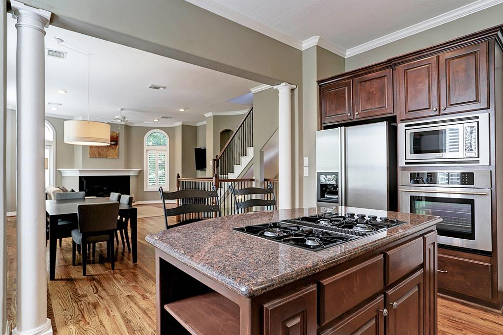Large and open kitchen with solid wood cabinets and granite countertops