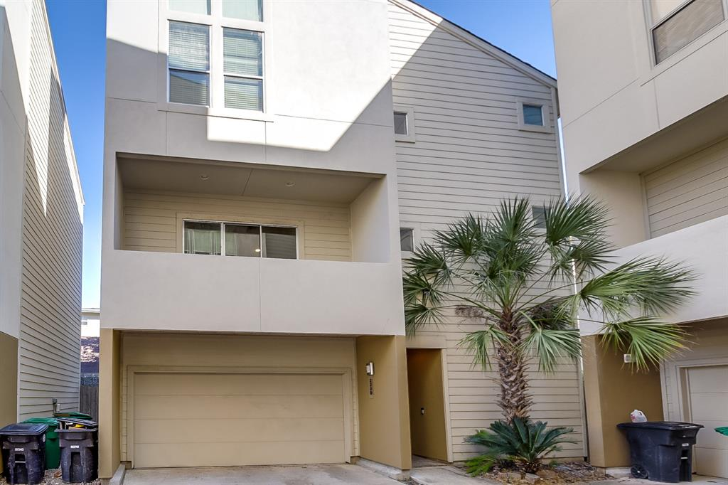 Built in 2004, this Houston three-story offers hardwood flooring, a fireplace, and a two-car garage. Upgraded features include fresh interior paint and a new roof.