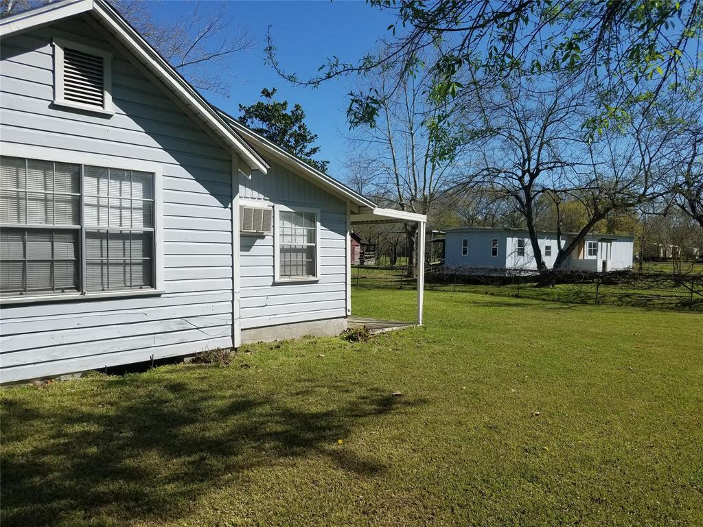 UNRESTRICTED 3.7775 ACRES WITH LARGE UPDATED 3 BED 2 BATH HOME  *  4 CAR GARAGE  *  OLDER REMODELED 2 BED 2 BATHL 14X72 TRAILER HOME  *  2 SEPTIC SYSTEMS  *  DEEP WELL  *  THERE IS A OLDER BARN & A NEWER BUILT METAL BARN 30X40  *  STORAGE SHED  *  NEWER BUILT RV PORT  *  FRUIT/PECAN BUSHES AND TREES  *  FENCED & CROSSED FENCED.