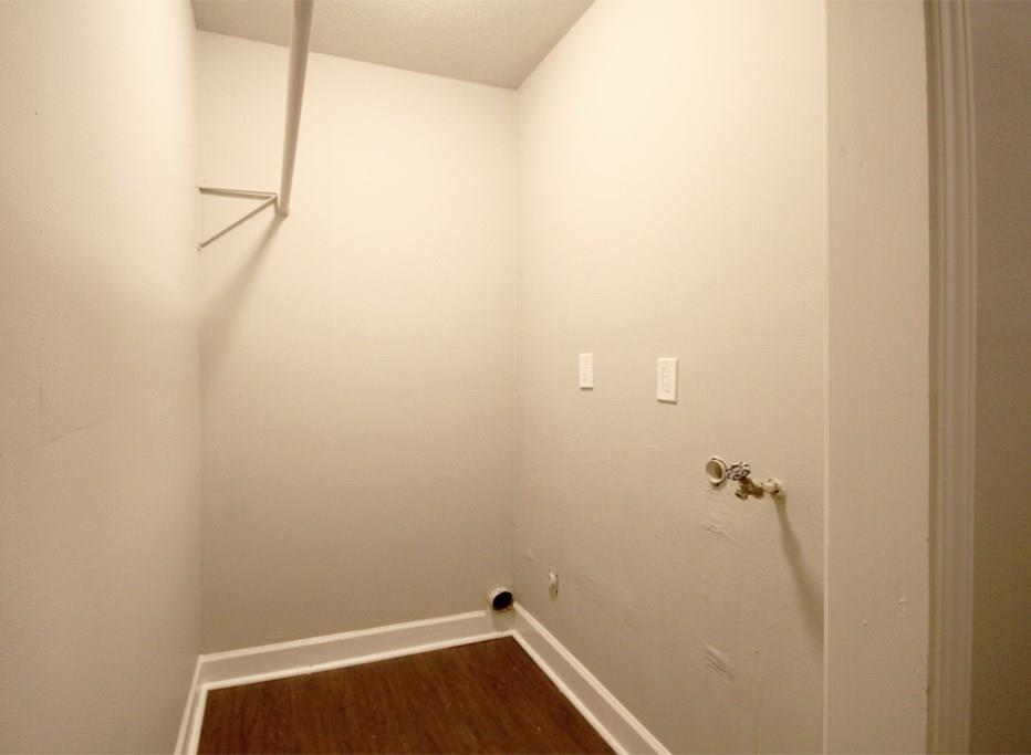 Laundry hookups with hanging storage off the rear mudroom