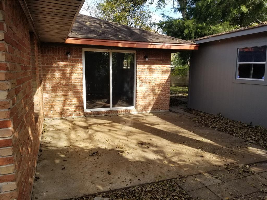 Concrete patio conveniently located off living room and kitchen in the fenced in backyard. Would be great for a BBQ or sitting area.