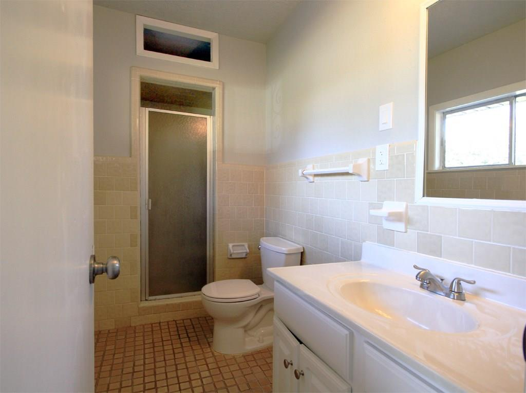 Second full bathroom off family room features shower