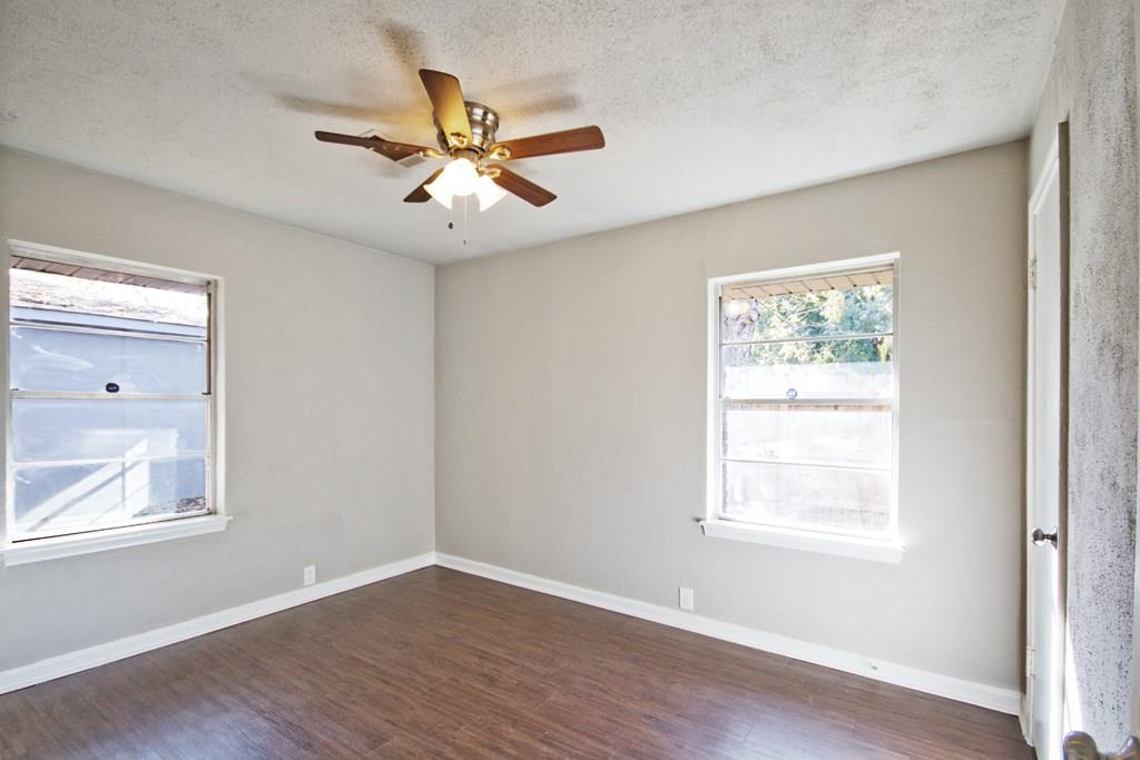 Bright second bedroom toward rear of house allows for additional privacy